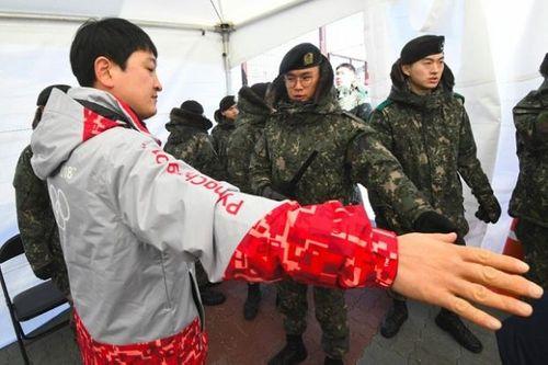 1200 nhân viên an ninh tại Olympic Pyeongchang bị cách ly để kiểm tra virus - Ảnh 1