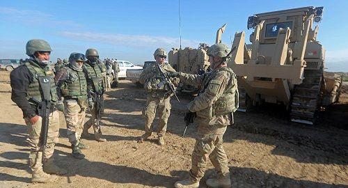 Mỹ tiếp tục thiết lập căn cứ ở biên giới Syria-Iraq, không có dấu hiệu rút quân - Ảnh 1