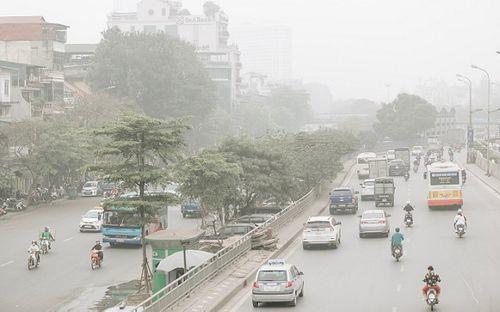 Hà Nội ngập trong sương bụi mù mịt, không khí ô nhiễm ở mức báo động - Ảnh 4