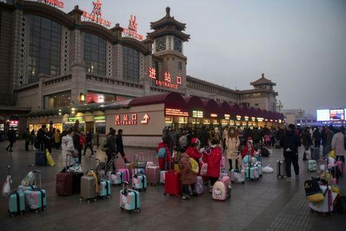 Ám ảnh cuộc di cư khổng lồ về quê ăn Tết ở Trung Quốc - Ảnh 2