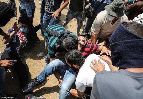 Nhiều quốc gia lên tiếng phản đối đụng độ kinh hoàng tại Dải Gaza - Ảnh 1