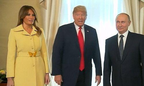 Video: Biểu cảm kỳ lạ của Đệ nhất Phu nhân Melania Trump sau khi bắt tay ông Putin - Ảnh 1