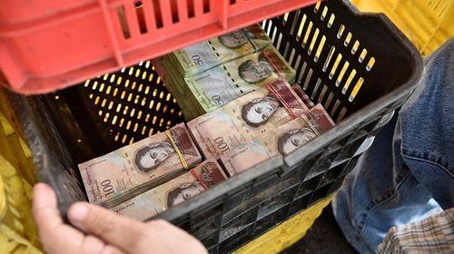 Lạm phát ở Venezuela: Thu ngân cân tiền cho nhanh thay vì đếm - Ảnh 6