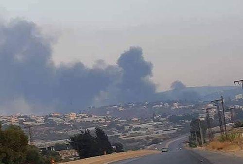 Israel ồ ạt nã tên lửa tấn công Syria, nhiều người thương vong - Ảnh 1