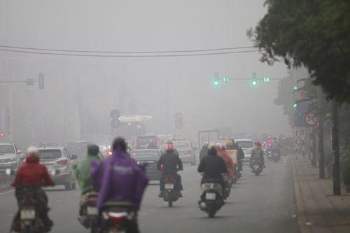 Chùm ảnh: Sương mù dày đặc, người dân thủ đô ngỡ như đang ở Sapa - Ảnh 3