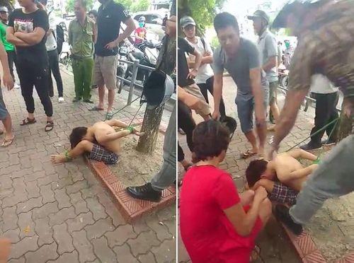 Vụ cậu bé đánh giày bị trói vào gốc cây: Tạm giữ 3 nghi phạm - Ảnh 1