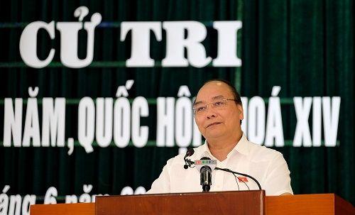 Thủ tướng Nguyễn Xuân Phúc trả lời về luật Đặc khu, luật An ninh mạng - Ảnh 1