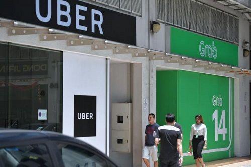 Grab, Uber bị phạt 9,5 triệu USD vì vụ sáp nhập ở Singapore  - Ảnh 1