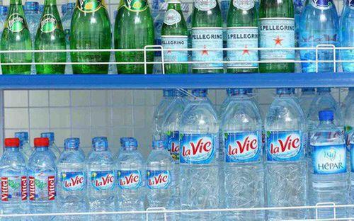 """Loạn thị trường nước uống đóng chai: """"Vàng thau lẫn lộn"""" - Ảnh 1"""