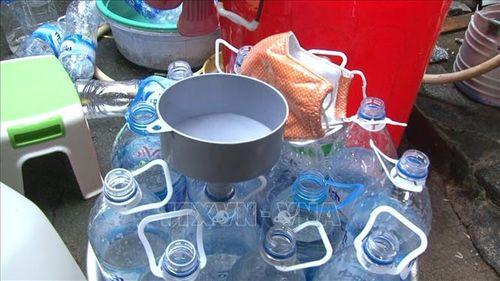 Quảng Ngãi: Kinh hoàng cơ sở sản xuất giấm ăn bằng axit và nước lã - Ảnh 2