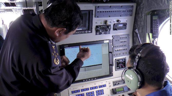 Toàn cảnh cuộc tìm kiếm máy bay Malaysia mất tích qua ảnh - ảnh 3
