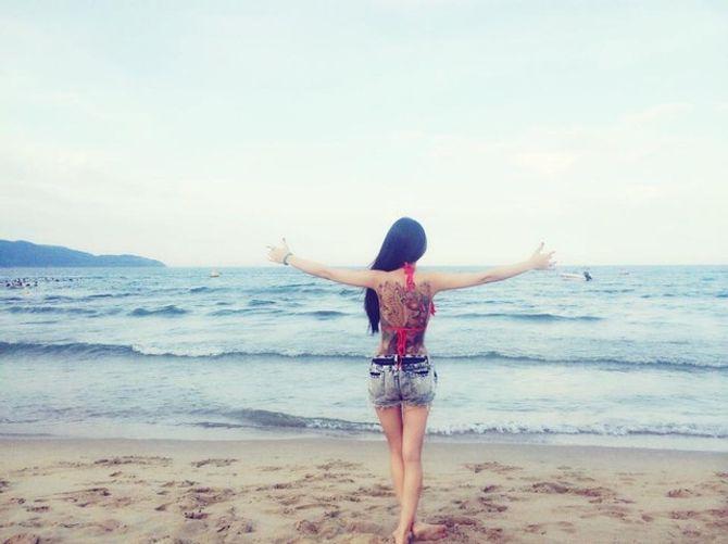 Cô gái có hình xăm khủng diện bikini ở Nha Trang là ai? - Ảnh 1