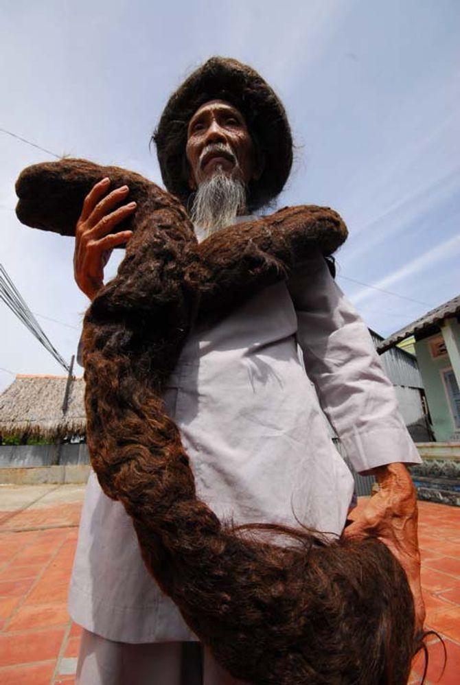 Những người sở hữu mái tóc dài nhất Việt Nam 4