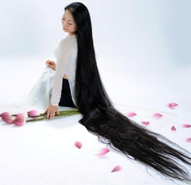 Những người sở hữu mái tóc dài nhất Việt Nam 6