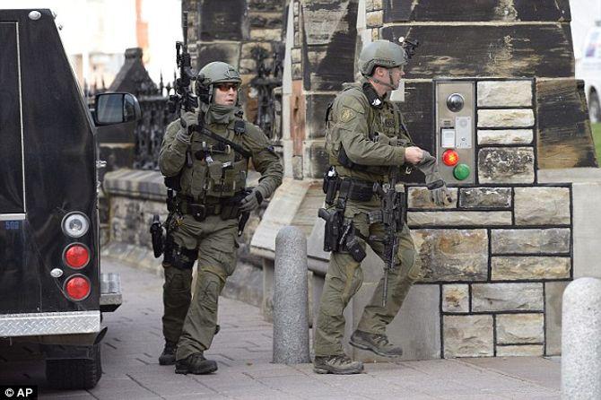 Hiện trường vụ xả súng kinh hoàng ở tòa nhà Quốc hội Canada - Ảnh 10