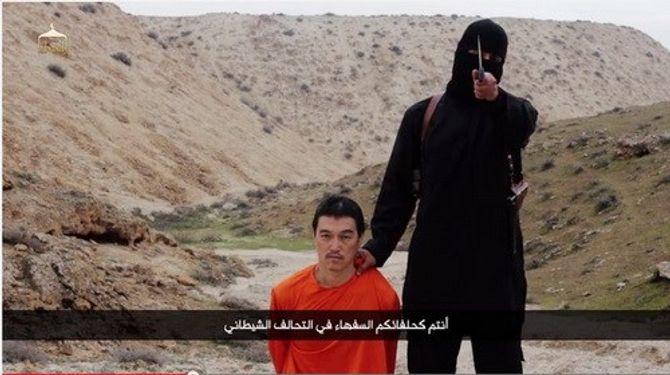 IS tung video chặt đầu con tin Nhật thứ hai Kenji Goto - Ảnh 1