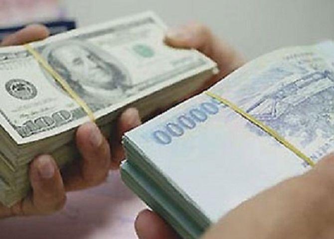 Vì sao Ngân hàng nhà nước nới tỷ giá USD/VND thêm 1%? - Ảnh 1