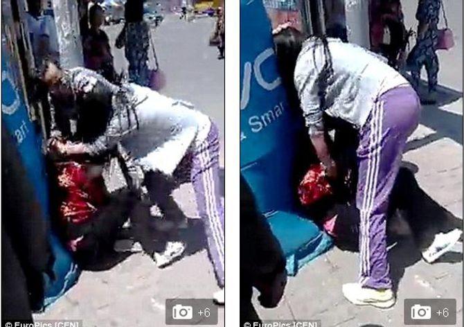 Cô gái đánh đập mẹ tâm thần giữa phố gây phẫn nộ - Ảnh 1