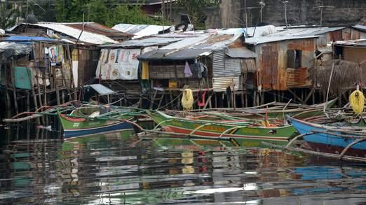 Cận cảnh siêu bão Haiyan tàn phá Philippines với sức gió 230km/h - Ảnh 2