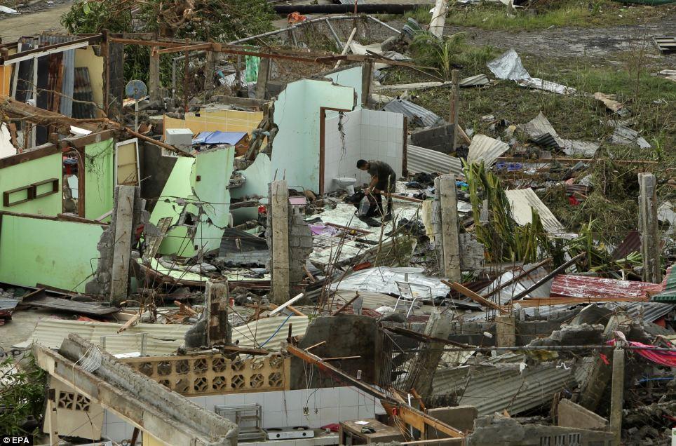 Xót xa Philippines sau siêu bão - Ảnh 4