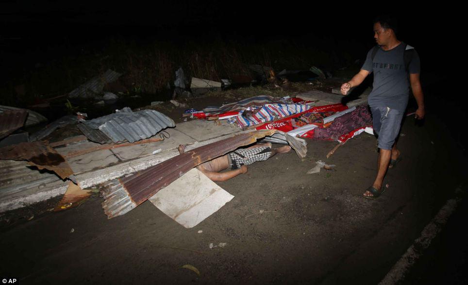 Xót xa Philippines sau siêu bão - Ảnh 11