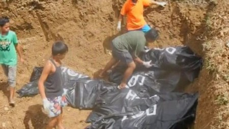 Philippines: Cận cảnh những hố chôn tập thể nạn nhân bão Haiyan - Ảnh 3