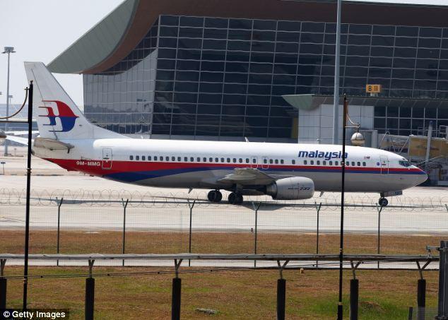 Malaysia công bố dữ liệu vệ tinh về MH370 mất tích - Ảnh 1