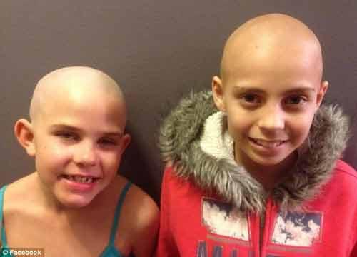 Cảm phục bé gái 9 tuổi cạo trọc đầu để động viên bạn ung thư - Ảnh 1