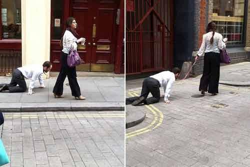 Kỳ lạ người phụ nữ dắt một quý ông như dắt chó đi dạo - Ảnh 1