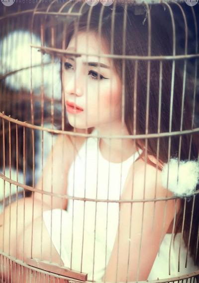 Hé lộ ảnh hậu trường của cô gái xinh đẹp chụp ảnh trong lồng chim - Ảnh 2