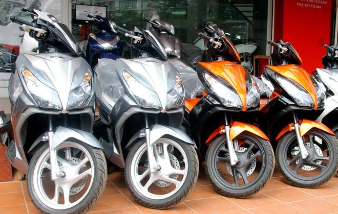 Xe tay ga Honda tăng giá mạnh ở Việt Nam - Ảnh 1