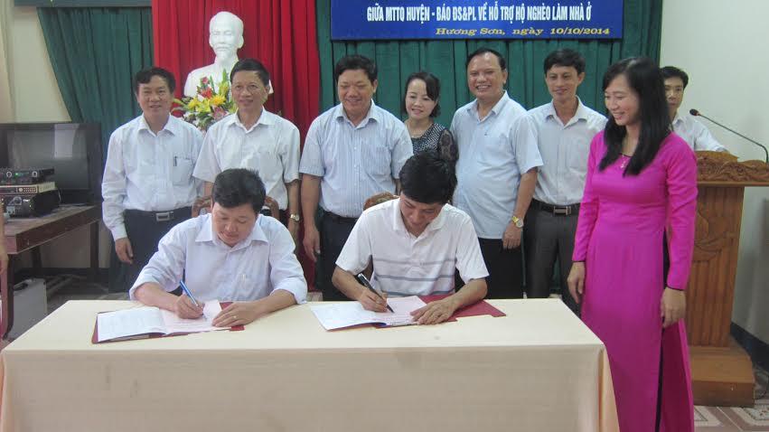 Báo ĐS&PL ký kết phối hợp xây mới 80 ngôi nhà cho người nghèo - Ảnh 1