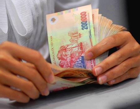 Tăng lương tối thiểu vùng:Cao nhất 3,1 triệu,thấp nhất 2,2 triệu  - Ảnh 1