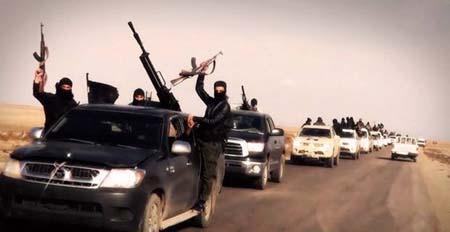 Phiến quân Hồi giáo IS hành quyết, bêu xác người quay phim - Ảnh 1