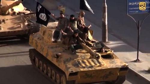 Vì sao IS trở thành tổ chức khủng bố giàu có nhất thế giới? - Ảnh 1