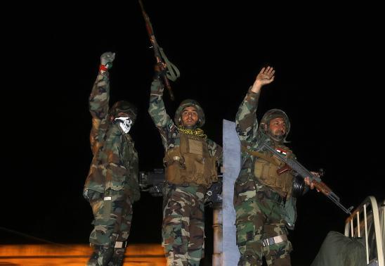 Người Kurd từ Iraq đã đến tiếp viện Kobani dưới sự yểm trợ của Mỹ - Ảnh 1