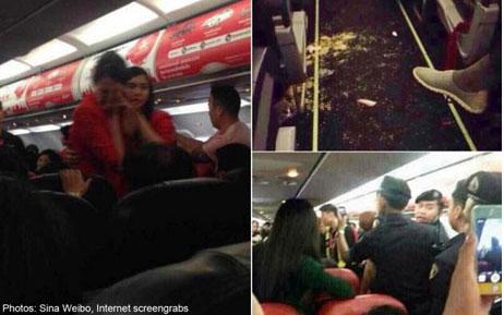 Trung Quốc phạt nặng hành khách tạt nước nóng vào tiếp viên  - Ảnh 1