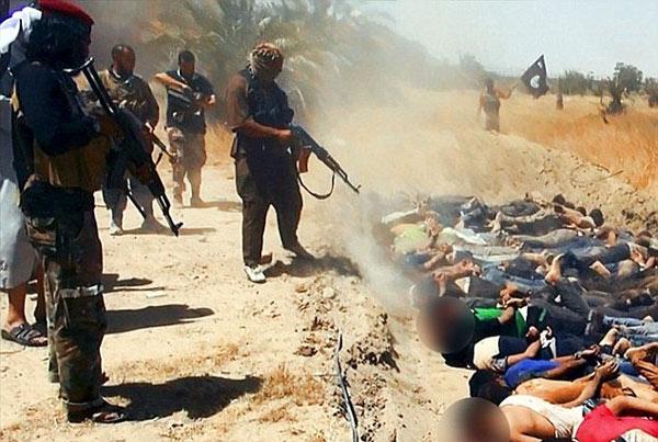 Phát hiện hố chôn hơn 230 thi thể bị IS thảm sát - Ảnh 1