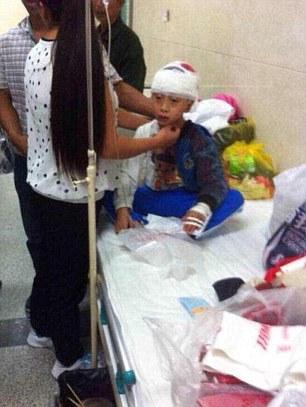Trung Quốc: Thầy giáo đánh học sinh đến chấn thương sọ não   - Ảnh 1