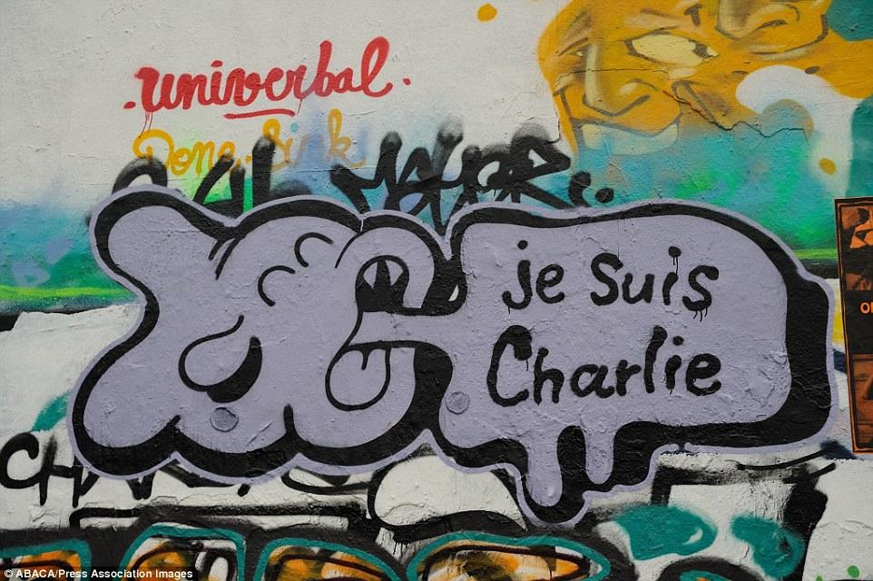 Khắp Paris tràn ngập tranh vẽ tưởng nhớ nạn nhân vụ Charlie Hebdo - Ảnh 12