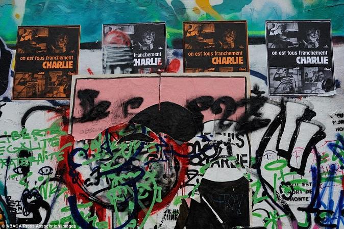 Khắp Paris tràn ngập tranh vẽ tưởng nhớ nạn nhân vụ Charlie Hebdo - Ảnh 18