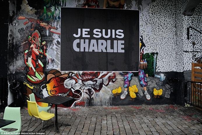 Khắp Paris tràn ngập tranh vẽ tưởng nhớ nạn nhân vụ Charlie Hebdo - Ảnh 2