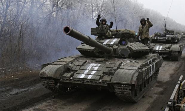 Giao tranh vẫn tiếp diễn ở Ukraine bất chấp lệnh ngừng bắn - Ảnh 1