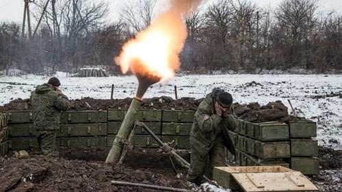 Súng vẫn nổ sau thỏa thuận ngừng bắn ở miền đông Ukraine - Ảnh 1