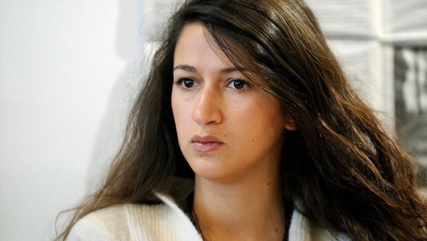 Nữ phóng viên Charlie Hebdo thề ủng hộ tạp chí dù bị dọa giết - Ảnh 1