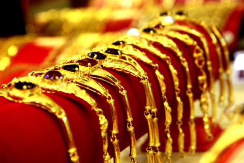 Giá vàng ngày 28/11: Giá vàng SJC giảm hơn 200.000 đồng/lượng - Ảnh 1