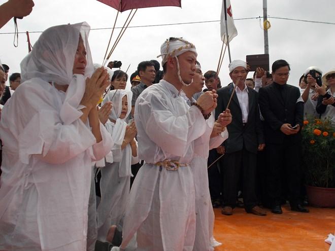 Hình ảnh nghẹn ngào tiễn đưa ông Nguyễn Bá Thanh ngày 30 Tết - Ảnh 9