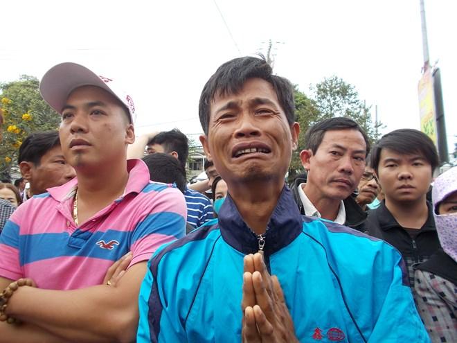 Hình ảnh nghẹn ngào tiễn đưa ông Nguyễn Bá Thanh ngày 30 Tết - Ảnh 5