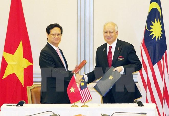 Thủ tướng Nguyễn Tấn Dũng hội đàm với Thủ tướng Malaysia Najib Rajak - Ảnh 1