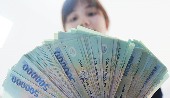 Vì sao nhiều lãnh đạo ngân hàng nhận thù lao tiền tỷ? - Ảnh 1